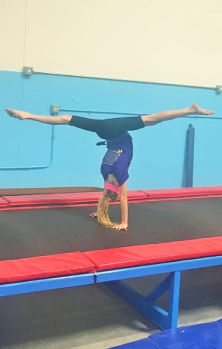 Becca split handstand
